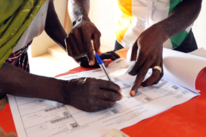 Person singing after voting in the polling station in  Ivory Coast © UN Photo/Hien Macline