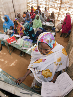 A view inside Abu Shouk Internally Displaced Persons (IDP) Camp's Women Center, in North Darfur, Sudan, where classes are offered in Arabic, the Koran and Mathematics. Approximately 80 women attend the classes, usually taking their children along with them. © UN Photo/Albert Gonzalez Farran